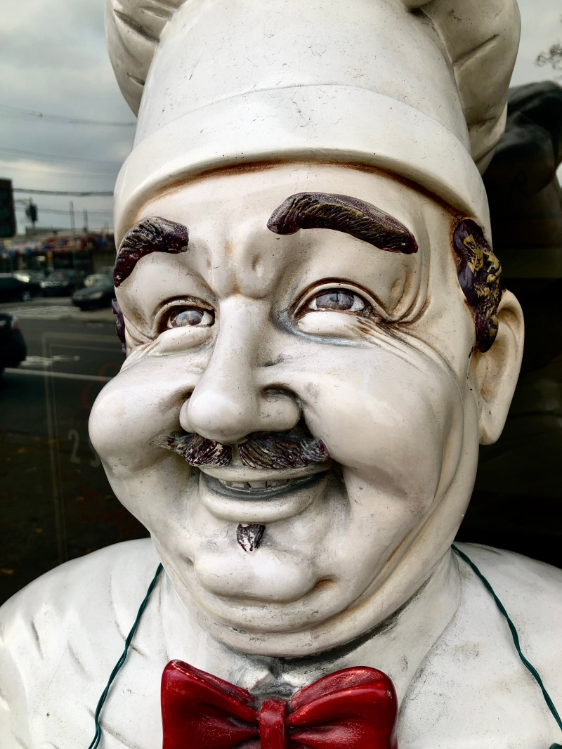 Paulie's Pizzeria mascot close up